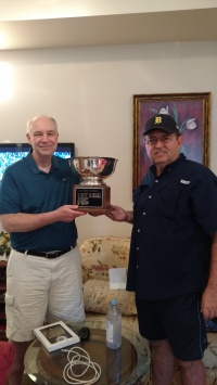 GaryKicinski is presented with the league trophy by Commissioner Dave Renbarger for winning the 2015 World Series.