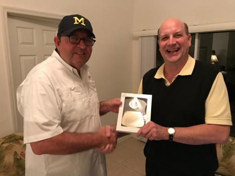 Commissioner Dave Renbarger, left, makes award presentation to 2017 World Series winner John McMillan.