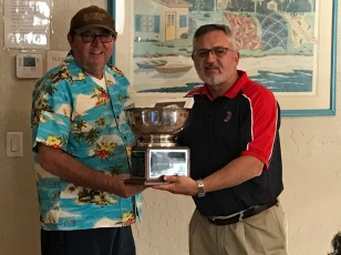 Commissioner Dave Renbarger, left, presents the league championship cup to 2019 World Series winner Steve Hart, manager of the Savannah Scorpions.